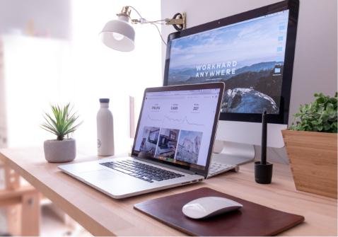 An image showing website design layout on laptop and desktop